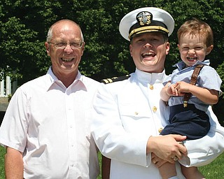Darrell Turney, 64, of Salem, with his son, Lt. Cmdr. Brian Turney, 31, and grandson, Connor, 2, of St. Marys, Ga.