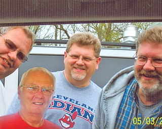 Shown with a cutout of their 71-year-old father, Arnold Welch of Austintown, are brothers Andrew, 47, of Austintown; Chuck, 49, of Newton Falls; and Dean, 45, Edinburg, Pa.