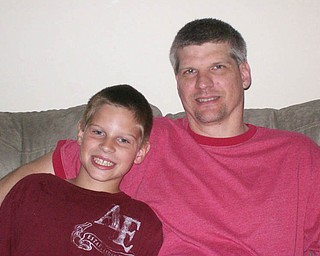 Keith Tincher and Jarod, 8, of Canfield.