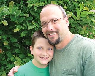 Matt Hartman, 40, and Dylan, 8 1/2, of Canfield.