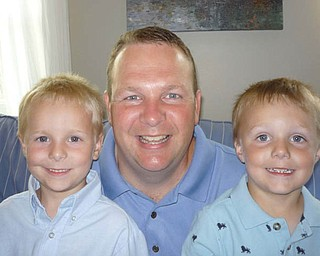 Matt McGlone with sons Eddie, 5, on the left and James, 4, of Canfield.