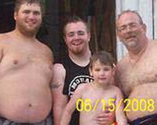 Ricky Jackson of Youngstown, 44, right, is pictured with his three sons, from left, Steven, 24, of Nashville; Tim, 21, of New Castle; and Zack, 7, of Youngstown.