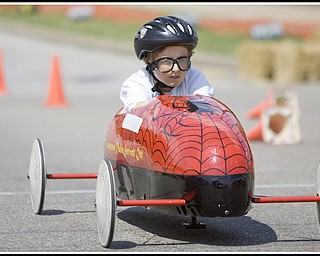 6.20.2009 Jason Fette races down 5th Ave. during The 2009 Greater Youngstown Area Soap Box Derby on Saturday afternoon. Photo by: Geoffrey Hauschild