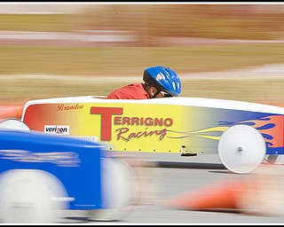 6.20.2009 Brandon Krohn races down 5th Ave. during The 2009 Greater Youngstown Area Soap Box Derby on Saturday afternoon. Photo by: Geoffrey Hauschild