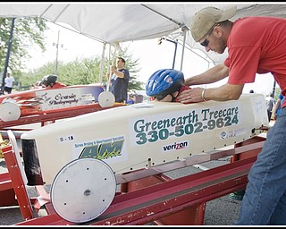 6.20.2009 Lia Brammer, age 9 of Poland, receives advice and affirmation from her father, James Brammer, about her positioning within the car before speeding down 5th Ave. during a race in The 2009 Greater Youngstown Area Soap Box Derby on Saturday afternoon. Geoffrey Hauschild