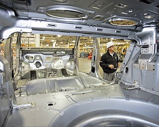 The underbody of the Chevrolet Cruze is shown as John Donahoe, plant manager for the GM Lordstown plant, talks about the new vehicle Wednesday, June 24, 2009, in Lordstown, Ohio. The Lordstown plant is currently shut down for retooling.