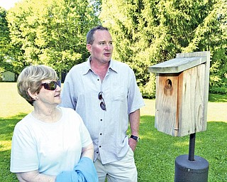 Norma Hazelbaker and Steve Queen stand in the backyard of Hazelbaker's Marion Drive home in Poland Tuesday. They are opposed to a plan to build apartment buildings nearby.