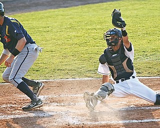 Scrappers catcher Dwight Childs (25) waits for the ump to acknowledge him during the second inning as David Rubinstein (15) scores for the State College Spikes at Eastwood Field, Wednesday June 24, 2009
