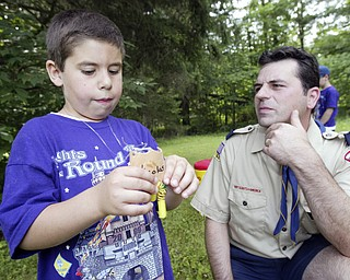 Tiger Cub Scout Nicolas DiTommaso, 6, shares amoment with his dad Anthony DiTommaso during Cub Scout Day Camp thursday at Camp Stambaugh in Canfield. They are members of Cub Scout Pack 2 in Poland. wd lewis