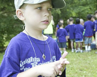Timmy Focht, 6, attends Cub Scout Day Camp at Camp Stambaugh in Canfield thursday. He is what is called a lone scout. He is traveling around the country withhis gradparents ina motor home and they chose Camp Stambaugh for him to atend. wd lewis