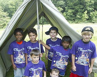 Cub Scouts from Pack 2 in Poland show off a tent they pitched while attending Cub Scout Day Camp at Camp Stambaugh in Canfield Thursday. from left they are: Kevin Rabindra, 9, Diego Calderon, 8, Michael Puhalla, 8, Victor DiTommaso, 9, Bobby Ramsey, 8, Ashlin Rabindra, 6, and Alec Catsoules, 8. WD LEWIS