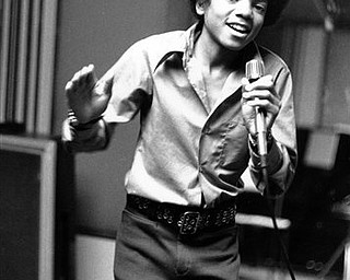 FILE - In this 1972 file photo, singer Michael Jackson at age 13, the youngest member of the singing group Jackson Five, sings in his home in Encino, Ca. (AP Photo, file)
