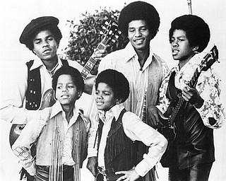 FILE - In this undated file photo, the Jackson 5, Michael Jackson, front right, Marlon Jackson, front left, Tito Jackson, back left, Jackie Jackson and Jermaine, back right, are shown in Los Angeles.  (AP Photo, file)