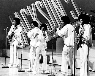 "FILE - In this Sept. 15, 1972 file photo, The Jackson 5, from left, Tito,  Marlon,  Michael, Jackie and Jermaine perform during the ""Sonny and Cher Comedy Hour"" in Los Angeles.  (AP Photo, file)"