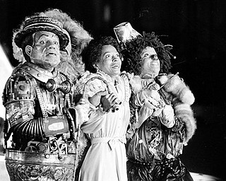 "FILE - In this Oct. 4, 1977 file photo, Diana Ross, center, as Dorothy, Michael Jackson, right, as Scarecrow, and Nipsey Russell as Tinman perform during filming of the musical ""The Wiz"" in New York.  Ted Ross, portraying the Lion, is partly hidden behind Russell.  (AP Photo, file)"