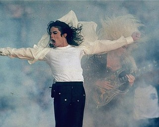 FILE - In this Jan. 31, 1993 file picture, Michael Jackson performs during the halftime show at the Super Bowl XXVII in Pasadena, Calif. Jackson has died in Los Angeles at age 50 on Thursday, June 25, 2009. (AP Photo/Rusty Kennedy, File)