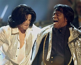FILE - In this Tuesday, June 24, 2003 file picture, Michael Jackson, left, performs with James Brown during the BET Awards in Los Angeles. Jackson later presented Brown with a  lifetime achievement award. Jackson has died in Los Angeles at age 50 on Thursday, June 25, 2009. (AP Photo/Kevork Djansezian)