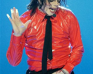 "FILE - In this Saturday, April 20, 2002 file picture, Michael Jackson performs ""Dangerous"" during the taping of the American Bandstand's 50th anniversary show in Pasadena, Calif. Jackson has died in Los Angeles at age 50 on Thursday, June 25, 2009. (AP Photo/Kevork Djansezian)"