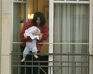 FILE - In this Tuesday Nov. 19, 2002 file picture made from video, Michael Jackson holds his child Prince Michael II, his head hidden by a towel, over a balcony of the Adlon Hotel in Berlin. Jackson, in Germany to attend an awards ceremony, had been waving to German fans, when he brought the baby onto the balcony. Jackson has died in Los Angeles at age 50 on Thursday, June 25, 2009. (AP Photo/APTN) ** TELEVISION OUT **