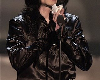 FILE - In this Monday, Oct. 27, 2003 file picture, Michael Jackson thanks the audience during the Radio Music Awards at the Aladdin Hotel in Las Vegas. Jackson has died in Los Angeles at age 50 on Thursday, June 25, 2009. (AP Photo/Joe Cavaretta)