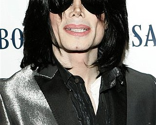 FILE -  In this Nov. 8, 2007 file photo, pop star Michael Jackson poses on the red carpet during the RainbowPUSH Coalition Los Angeles 10th annual awards in Los Angeles. (AP Photo/Danny Moloshok, file)