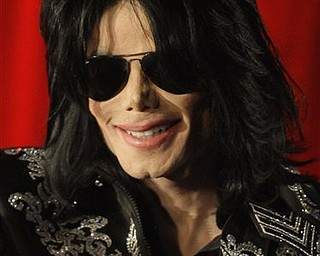 FILE - In this March 5, 2009 file photo, US singer Michael Jackson is shown at a press conference in London, announcing plans to appear at the London O2 Arena in July. Jackson, 50, died in Los Angeles on Thursday, June 25, 2009. (AP Photo/Joel Ryan, file)