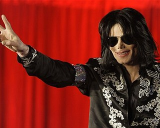 FILE - In this March 5, 2009 file photo, Michael Jackson announces that he is set to play ten live concerts at the London O2 Arena in July, which he announced at a press conference at the London O2 Arena. (AP Photo/Joel Ryan, file)