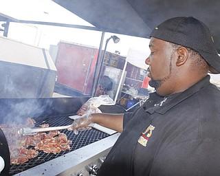 Representing Guy's BBQ in Newton Falls, Steve Jackson cooks pulled pork at the Mahoning Valley Rib Burnoff Saturday June 27, 2009Lisa-Ann Ishihara
