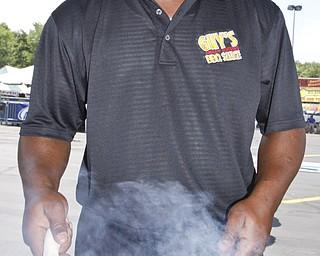 Representing Guy's BBQ in Newton Falls, Kevin Hughes cooks ribs at the Mahoning Valley Rib Burnoff Saturday June 27, 2009Lisa-Ann Ishihara