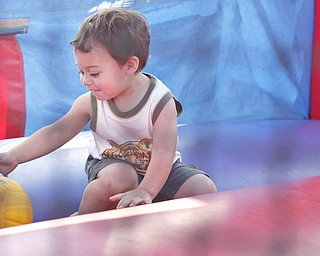 Colton Huff (21 mths) of Cortland plays inside an inflatable slide/play area at the Mahoning Valley Rib Burnoff Saturday June 27, 2009