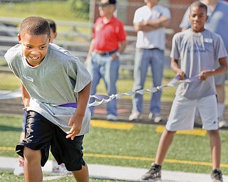 Jared Perdue, 9, of Youngstown and Aaron Woodberry, 11, of Youngstown participate in an exercise to test their agility during Cardinal Mooney Camp of Champions at the football field, Monday June 29, 2009.