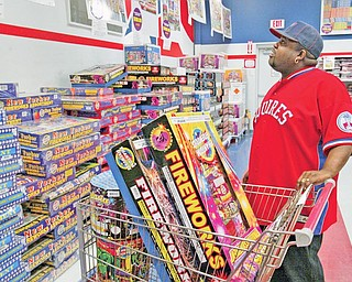 JULY FOURTH FIREPOWER: Barry White of Duquesne, Pa., shops for fireworks at Phantom Fireworks on Market Street in Youngstown.