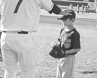Special to The Vindicator TOUCHING SITUATION: Ryan Kopcial, the winner of The Vindicator's Most Valuable Kid Contest, gets a pat on the head and a word of advice from Roberto Perez, catcher for the Scrappers, before he throws the first ceremonial pitch at the game between the Scrappers and State College Spikes on June 22 at Eastwood Field. The youngster, a son of George and Karolyn Kopcial of Austintown, received the ball as a souvenir. Entry forms for the contest run each Sunday in The Vindicator and are available at the customer service counter. One winner of the contest will be chosen to throw out the first pitch and will receive four tickets to each of the Scrapper's 38 home games.