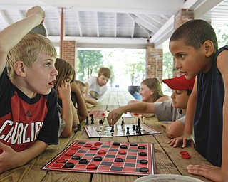 Dylan Alders (9) of Liberty plays Michael Brown (9) of Liberty in a game of checkers during summer day camp in Churchill Park in Liberty run by Rose Buhley, Monday June 29, 2009Lisa-Ann Ishihara