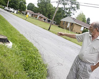 Raymond Matuz points out the poor sewer system in his Poland neighborhood. Tuesday June 30, 2009Lisa-Ann Ishihara