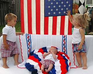 Tom and Erin Chizmar of Youngstown share this picture of their three grandchildren celebrating the Fourth of July and Caleb's (left) second birthday. With him are Cameron, center, who was born on Memorial Day in 2008, and Scarlet.
