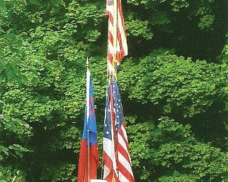 Members of the Austintown Fitch Color Guard participating in the Fourth of July Flag Raising Ceremony at the Austin Log Cabin in 2008 are, from left, captain Liana DeFuria, co-captain Alissa Breakiron, and standing guard Katie Fabrizio, Samantha Devenport and Alyssa Yacovone, all of Austintown.