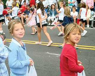 Got candy? Emily Yasechko, left, and Nicole Yasechko of New Middletown are attending the Canfield parade.