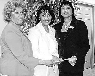 <p>Special to The Vindicator</p> <p>LINKED: The Links, Incorporated, President Anne R. Cobbin, left, and social committee chair Marge Staples, right, present a $1,850 check to Lois Clark, Headstart program director, center.</p>