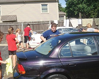 <p>Special to The Vindicator</p> <p>MISSION POSSIBLE: Members of St. Nicholas Parish Youth Group washed cars from 9 a.m. to 2 p.m. on Saturday at the Auto Zone on Youngstown-Poland Road to raise funds for a mission trip to help with the Hurricane Katrina 2009 Reconstruction Season in New Orleans. </p>