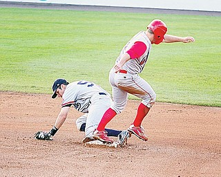 SCRAPPERS - Carl Uhl (2) of Williamsport beats Short Stop Kyle Smith to the bag Thursday night at Eastwood Field.