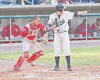 SCRAPPERS - Catcher Sebastian Valle goes after a loose ball as (22) Kyle Bellows holds a teammate on third Thursday night at Eastwood Field.