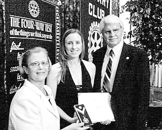 """Special to The Vindicator  THREE OF A KIND: The Rotary Club of Youngstown presented the Paul Harris Fellow award to Miranda Young at the annual Presidents Ball on June 24. The presentation was made in recognition of her work as head of the mentoring program with Rotary's """"Put Kids First"""" project. Young, an associate in the Youngstown office of Hill, Barth and King, center, is joined by Carol Sherman, at left, and Frank Kishel, past recipients of the award, which is the highest honor bestowed upon a member of Rotary International."""