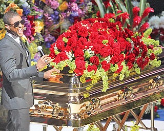 Usher performs Tuesday at Michael Jackson's funeral service at the Staples Center.