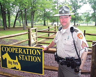 Sgt. Kevin Kuriatnyk, a park officer at Mosquito Lake State Park,  stands near the entrance to the nearly complete Cooperation Station  leashless dog park. The park is located inside Mosquito Lake State  Park near the beach. The project was a joint effort of the state park  and the Trumbull County MetroParks Board. The official grand opening  will be at 1 p.m. July 17.