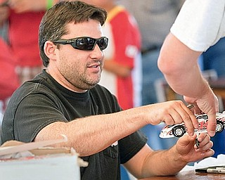 Tony Stewart signs autographs for fans at Sharon Speedway on Tuesday evening.