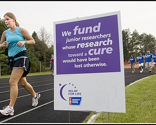 7.10.2009 Amanda Watanakunakorn, of Canfield, runs for a friend surviving Leukemia, at Poland High School's Stadium during the Relay for Life on Friday evening. Geoffrey Hauschild