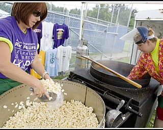 7.10.2009 Rebecca Fisher, of Girard, scoops kettle corn along side her daughter in order to raise money during the Relay for Life at Poland's High School Stadium on Friday afternoon. Rebecca wears a purple shirt symbolizing her survival of skin cancer which she was diagnosed with in 1998. Geoffrey Hauschild