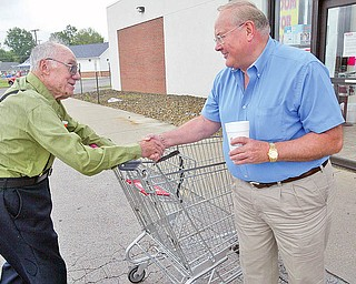 Henry Nemenz ,Poland Save A Lot store owner, RIGHT, greets longtime shopper Thomas Ziccardi 87 of Poland outside the store. wd lewis