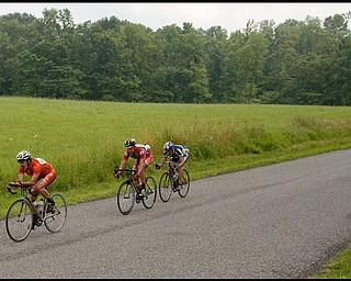 7.11.2009 Ray Russell, of Beaver PA, leads the front pack along Fairfield School Rd. in Columbiana followed by Nate Loman, of Fairlawn, and John Fiumara, of New Middletown, during the Master's class of the Tour of the Valley on Saturday afternoon. Geoffrey Hauschild